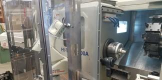 RFA-Microtherm-Kawasaki-Robot-Loader-schuifbare-omkasting