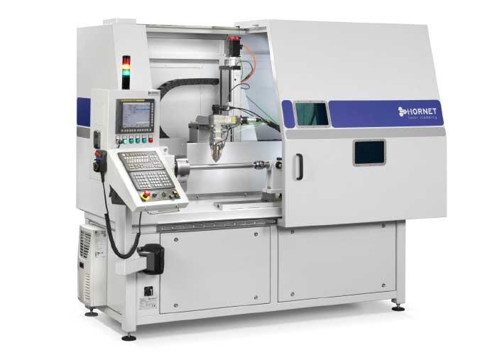 Een standaard lasercladmachine met daarin diverse eigen ontwikkelingen van Hornet.
